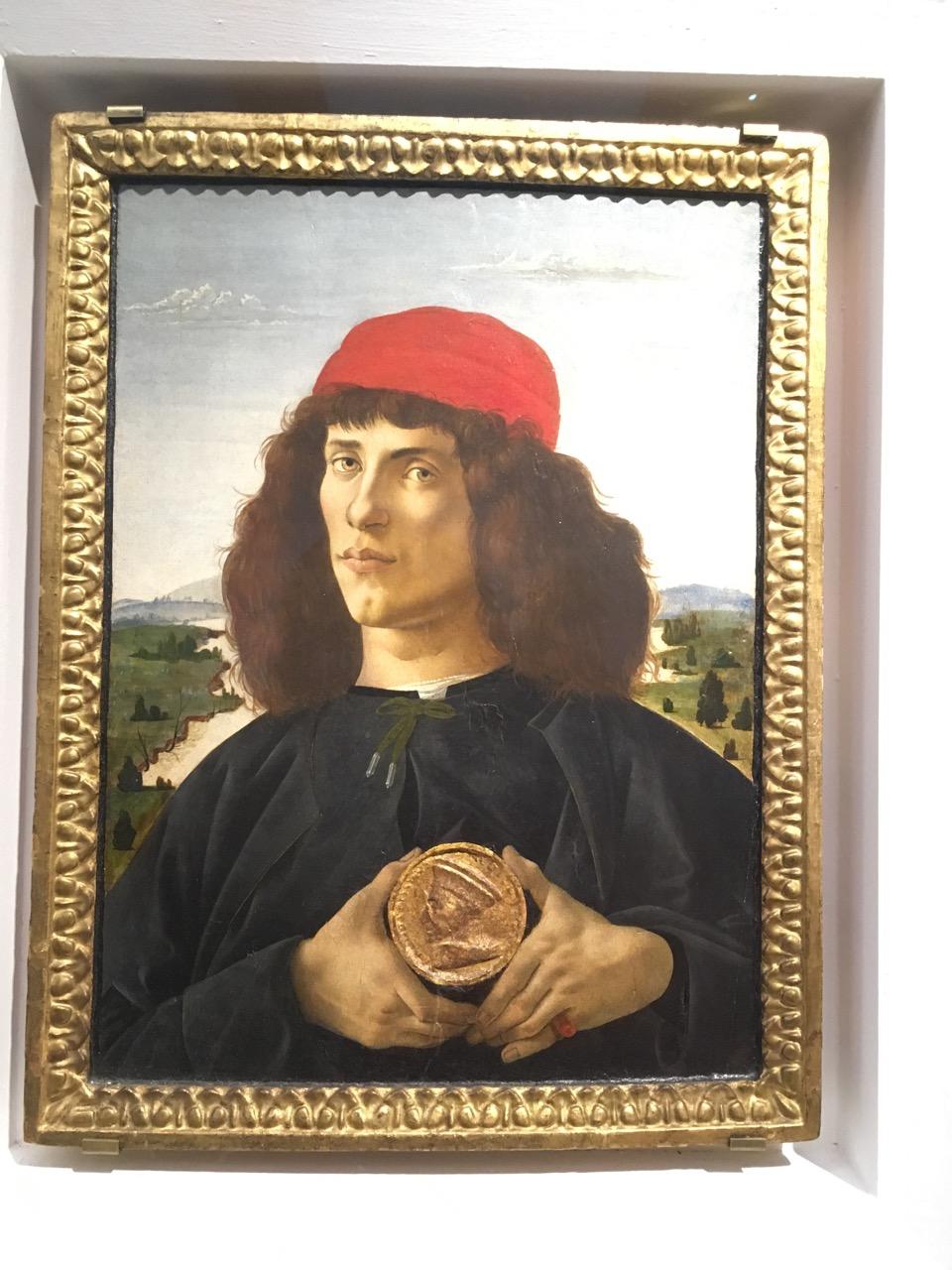 桑德罗·波提切利的《手持老科西莫勋章的男子肖像》,1475